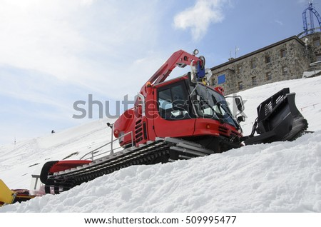 photo of snowgroomer in winter