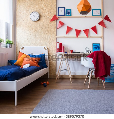 Photo of spacious and contemporary interior of teenager room - stock photo