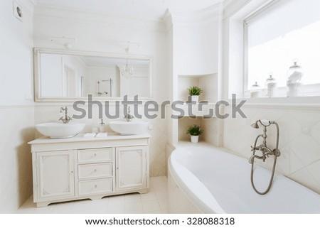 Photo of spacious bathroom with big bathtub - stock photo