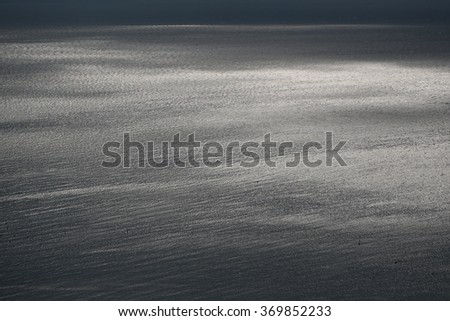 Photo of spectacular maritime seashore and sea with ripples low waves against grey sky at dull murky day over seascape background, horizontal picture