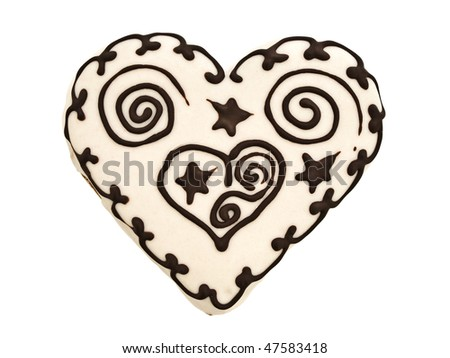 Photo of spice cake in heart shape against white background - stock photo