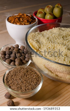 Photo of spices in dishes, wood background, darkness
