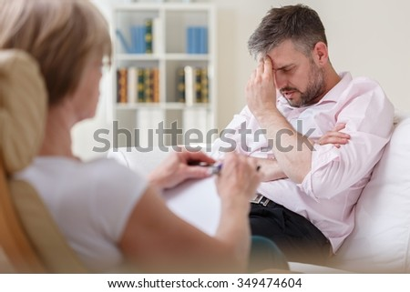 Photo of stressed businessman with mental problem - stock photo