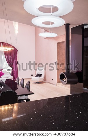 Photo of stylish contemporary interior with decorative fireplace - stock photo