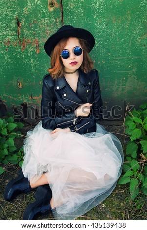 photo of stylish girl in black leather jacket and long skirt - stock photo