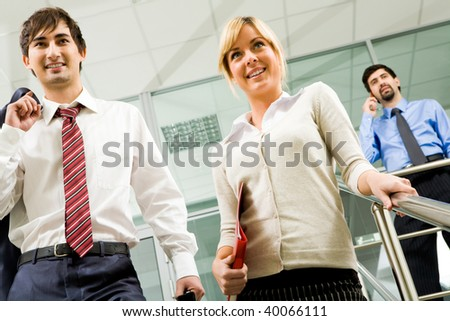 Photo of successful business partners in office building