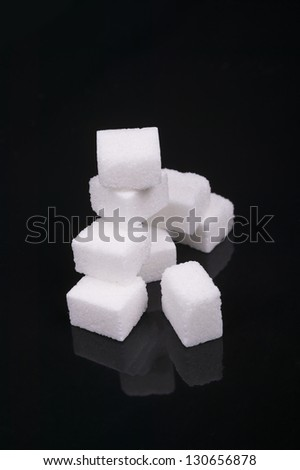 photo of sugar cube isolated on a black background