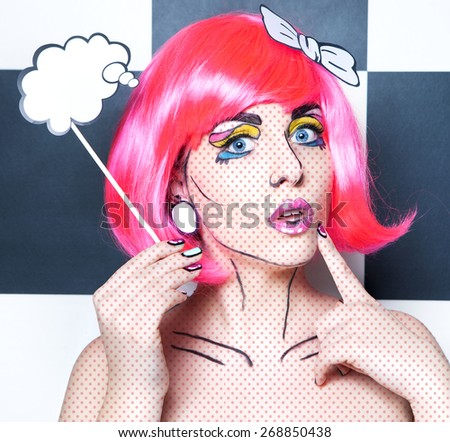 Photo of surprised young woman with talk bubble and professional comic pop art make up and accessories - stock photo
