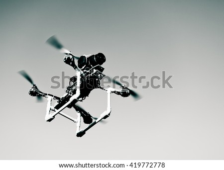 Photo of surveillance drone with onboard camera - stock photo