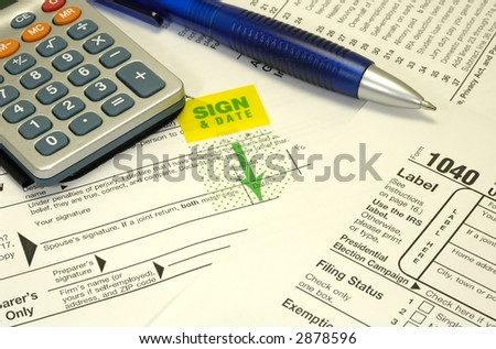 Photo of Tax Forms and a Pen - Tax Related Items