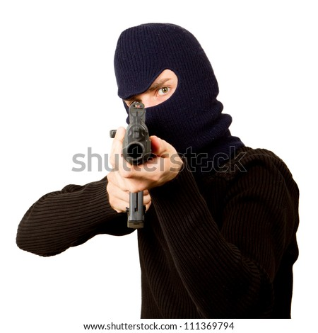 Photo of terrorist with gun attacking someone while pointing it forwards
