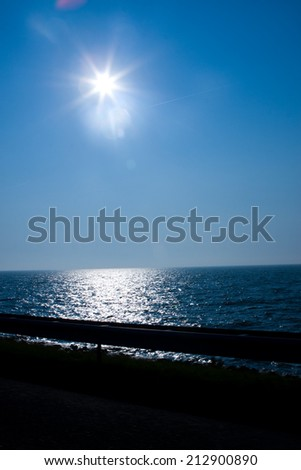 photo of the beautiful sunset at the seaside - stock photo