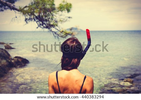 photo of the beautiful young woman in Greece on the sea background - stock photo