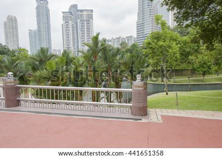 Photo of the bridge overlooking the Park area near twin towers in Kuala Lumpur, Malaysia - stock photo