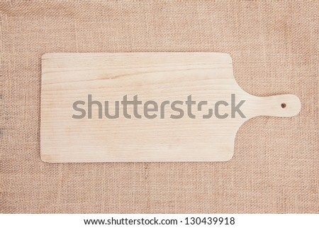 Photo of the cutting board on sacking background