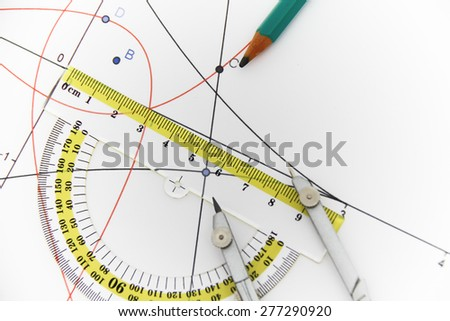 Photo of the Drawing tools with compass - business concept - stock photo