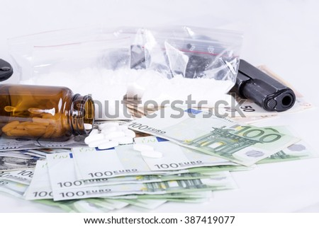 photo of the drugs, cocaine , money and gun
