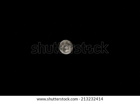 Photo of the full moon on black sky - stock photo
