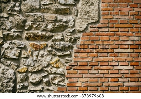 Photo of The Grunge Vintage Brick and Stone Wall - stock photo