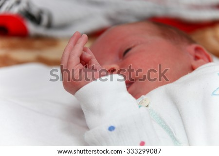 Photo of the Hand of the little male baby