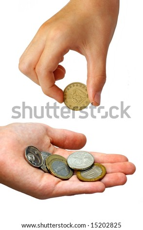 Photo of the hand putting coins in a palm on white background