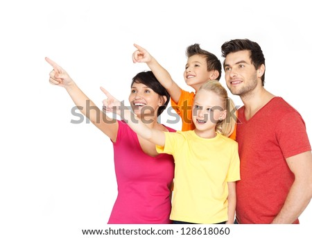 Photo of the happy young family with two children pointing finger up-  isolated on white background - stock photo