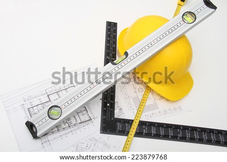 Photo of the Helmet and tools for construction drawings and buildings - stock photo