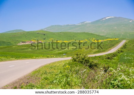 Photo of the landscape with rural road, Armenia - stock photo