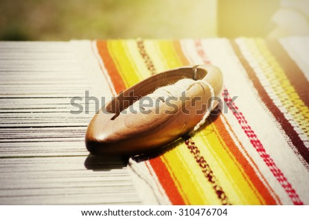 Photo of the Loom Tools and Wool Fabric - stock photo
