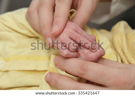 Photo of the Mother and her Newborn Baby, Parent holding newborns hands, Happy Mother and Baby together