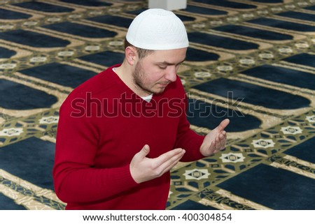 Photo of the Muslim Man Is Praying In The Mosque - stock photo