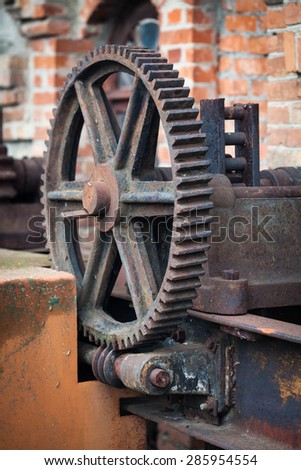 Photo of the old rusty gears, machinery parts. - stock photo