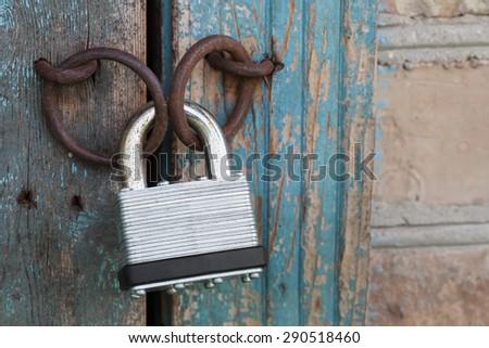 Photo of the padlock and old metal hasp closeup - stock photo
