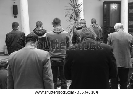 Photo of the Prayer performing by muslim men