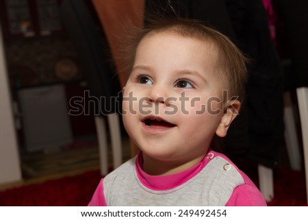 Photo of the Pretty curly toddler drying her hair - stock photo