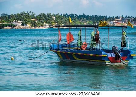 Photo of the seascape with motor boat, ceylon, unawatuna - stock photo