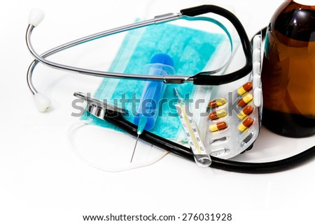 Photo of the Set for flu treatment, thermometer, nasal sprays, protective surgical mask, stethoscope, syringe... - stock photo