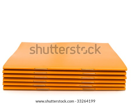 photo of the some orange booklets against the white background - stock photo