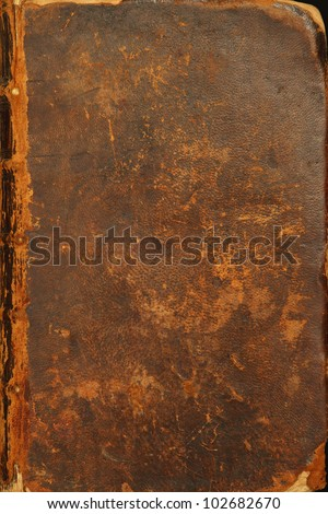 Photo of the tattered cover of a bible from 1786. - stock photo