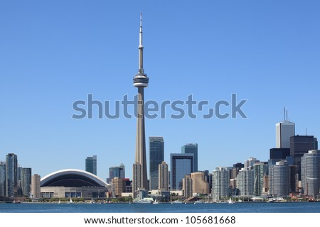 Photo of the Toronto skyline under a clear sky. - stock photo