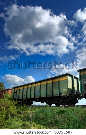 Photo of the train wagons in the natural scenery - stock photo