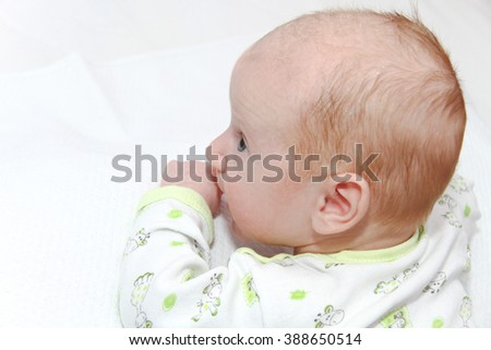Photo of the Two months old newborn male baby enjoying