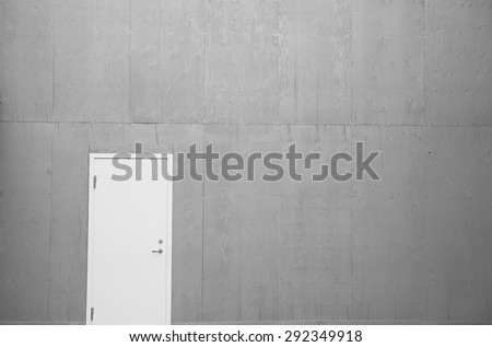 Photo of the white door with huge wooden wall - stock photo