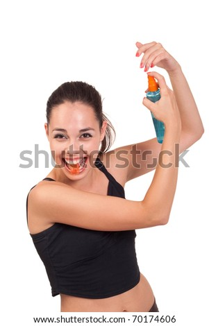 Photo of the young girl with spray posing to camera