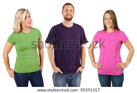Photo of three young adults wearing different coloured blank t-shirts. Ready for your design or artwork. - stock photo
