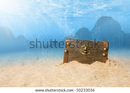photo of treasure chest submerged underwater with light rays - stock photo