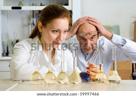 photo of two chemists, who make experiments in the chemistry lab.