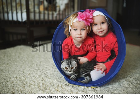 photo of two cute twin girls portrait - stock photo