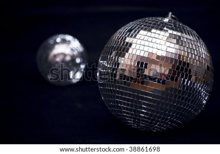 Photo of two disco balls on a black background - stock photo