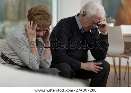 Photo of two elderly people having conflict in marriage - stock photo